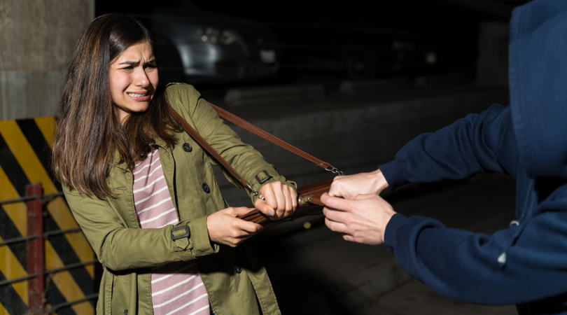 A woman practices self defense